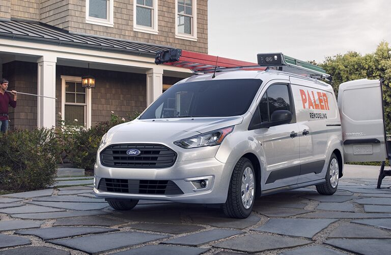 Silver 2020 Ford Transit Connect Cargo Van parked near a house