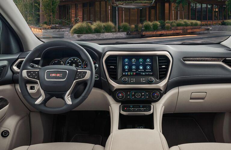 Steering wheel, gauges, and touchscreen in 2020 GMC Acadia