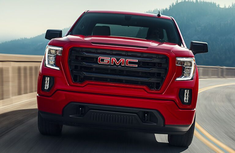 exterior front view of 2020 GMC Sierra 1500 as it drives on a highway