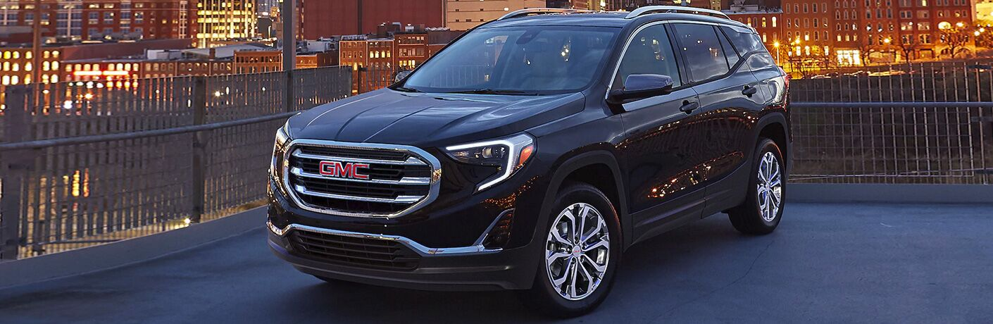 2020 GMC Terrain parked with city in background at night