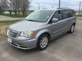 Driver's side exterior view of a grey Chrysler Town & Country