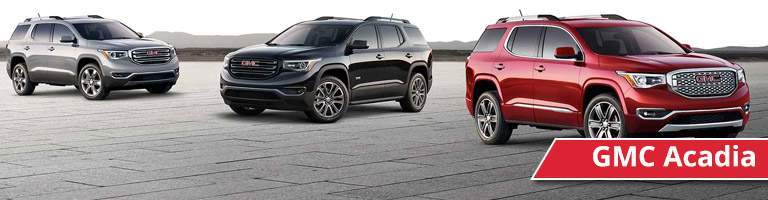 Exterior view of a gray, black and red GMC Acadia