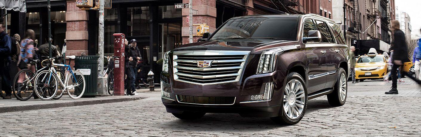 Cadillac Escalade driving through NYC neighborhood