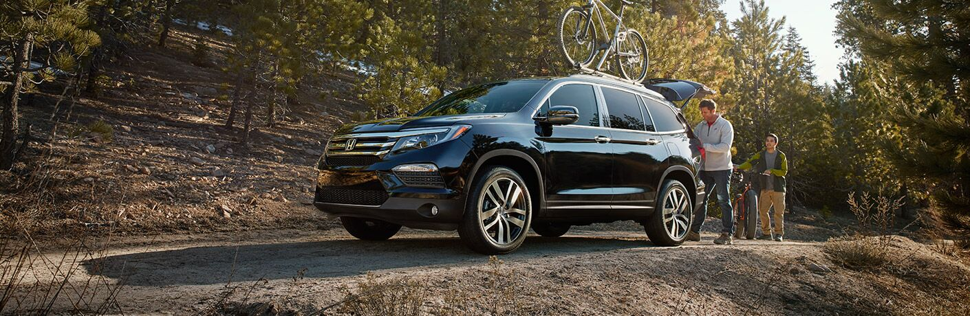 Loaded Honda Pilot out in the woods