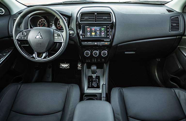 Front dash, steering wheel, and infotainment system of 2018 Mitsubishi Outlander Sport