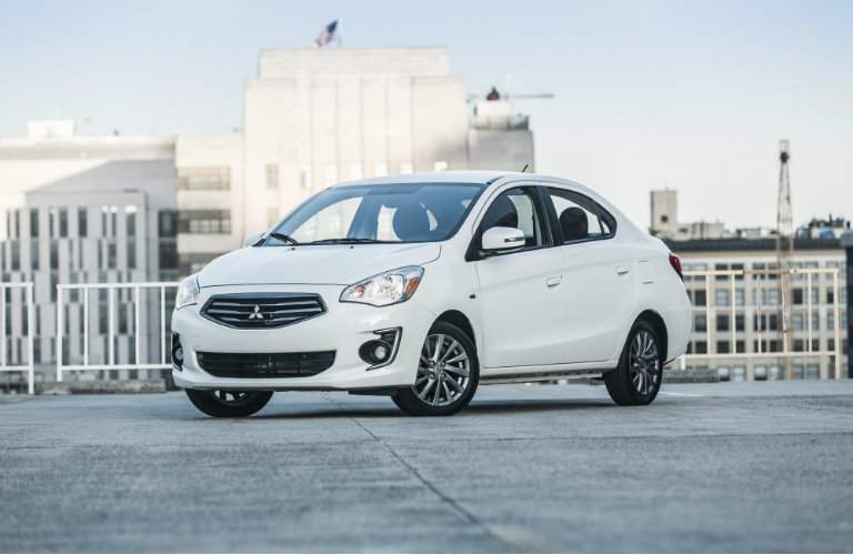 White 2018 Mitsubishi Mirage G4 parked on a city rooftop
