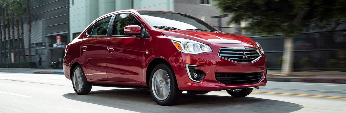 Front/side profile of red 2019 Mitsubishi Mirage G4