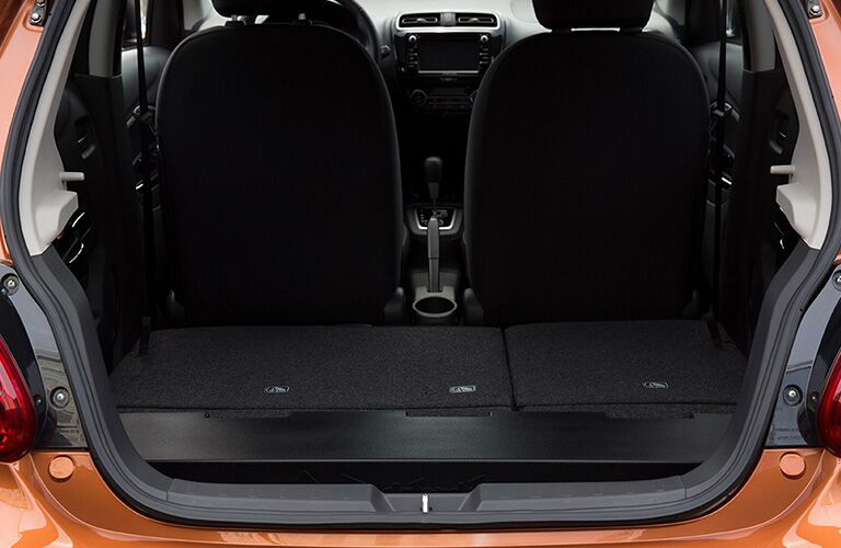 Cargo area of 2019 Mitsubishi Mirage with collapsed rear seats