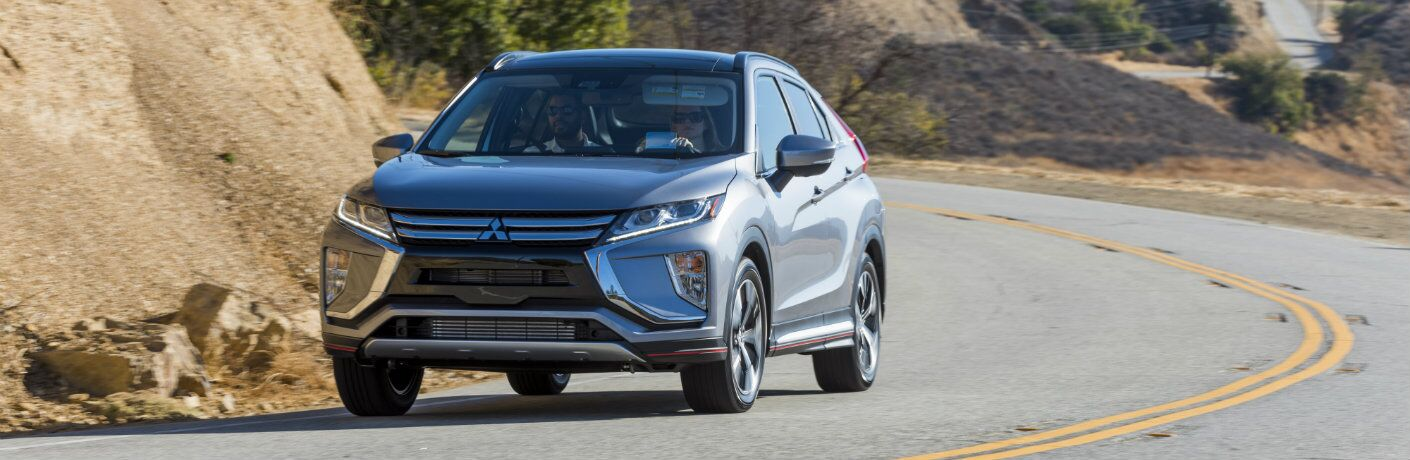 Silver-colored 2018 Mitsubishi Eclipse Cross on a road trip through a mountain pass