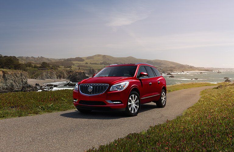 red 2017 Buick Enclave driving on mountain road
