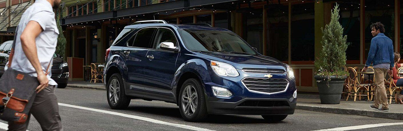 blue 2017 Chevrolet Equinox exterior front side view driving down street