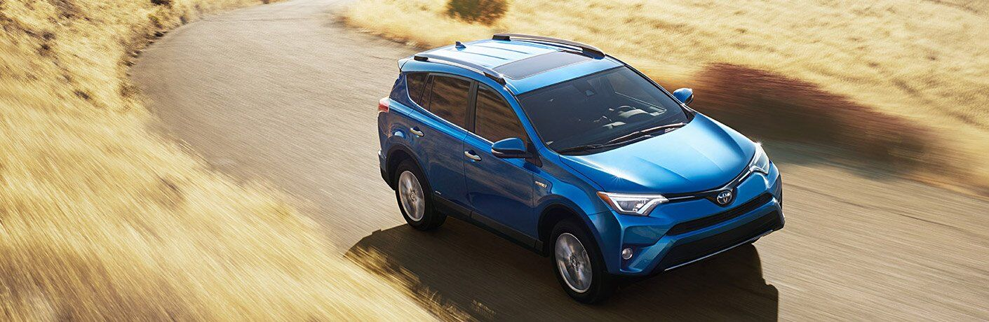 2016 Toyota RAV4 driving on dirt road