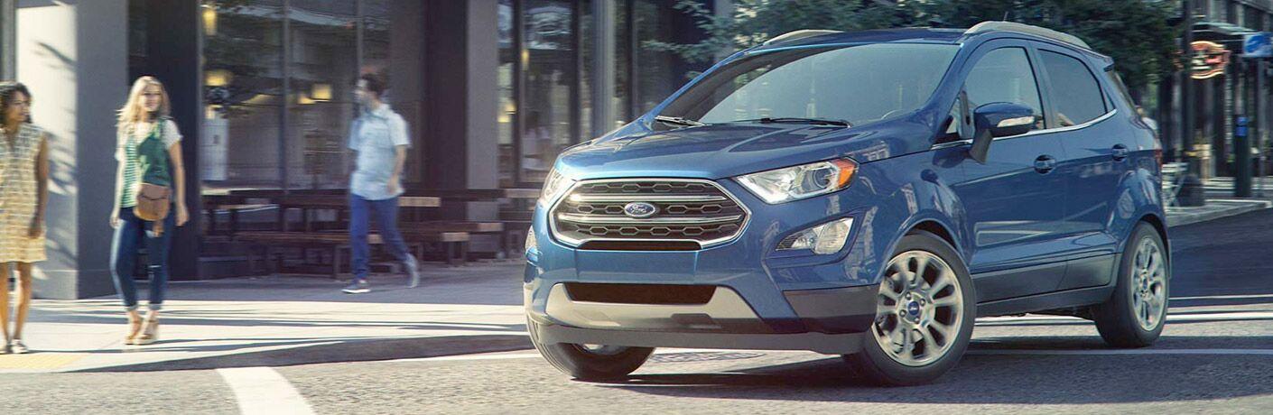 2018 Ford EcoSport driving past a shopping center