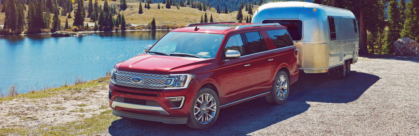 2018 Ford Expedition in red tows trailer