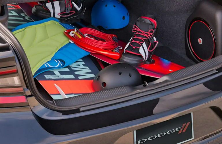 2018 Dodge Charger cargo area filled with sports gear