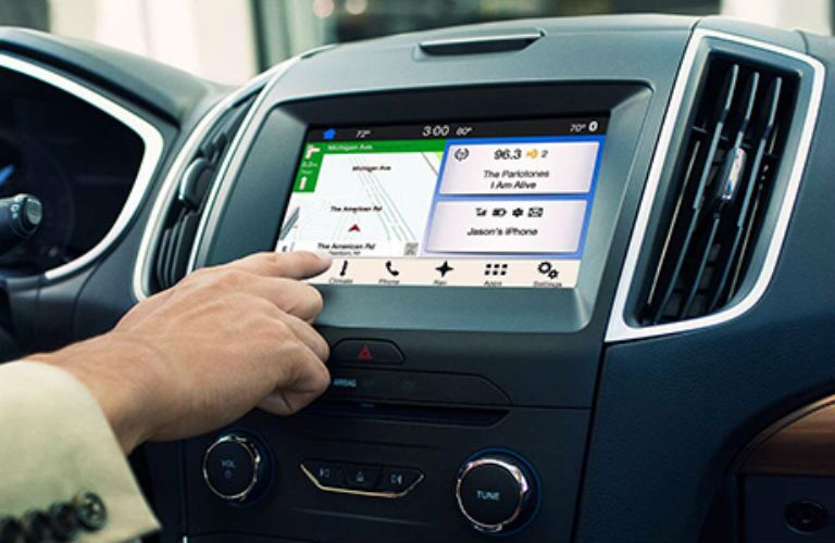 2018 Ford Edge person using SYNC 3 with Navigation System