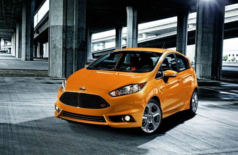2018 Ford Fiesta in Orange Fury in a parking garage