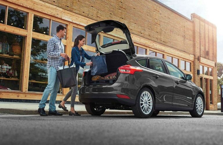 2018 Ford Focus Hatchback in Magnetic with couple loading cargo