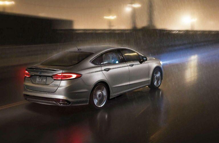 2018 Ford Fusion driving through the rain