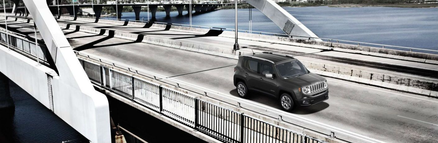 2018 Jeep Renegade driving over a big bridge