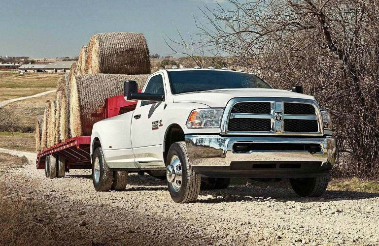 2018 Ram 3500 with goodneck towing hay bales