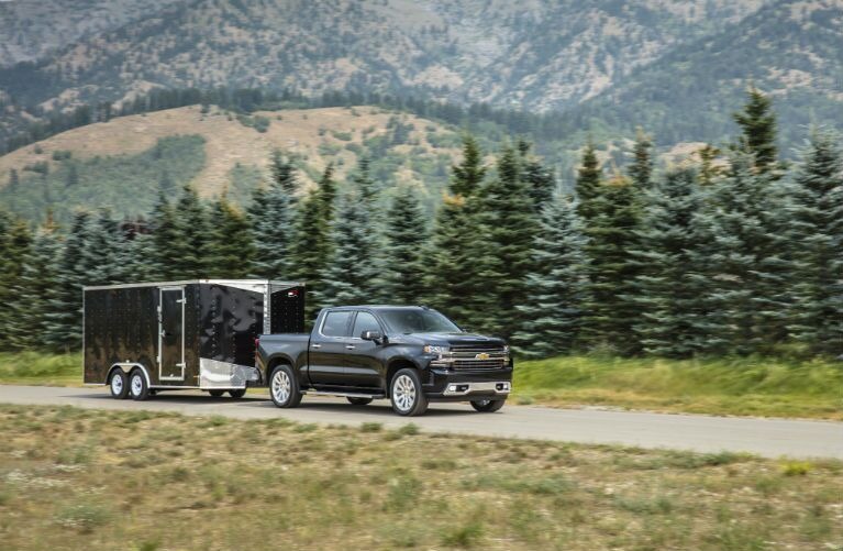 2019 Chevrolet Silverado 1500 towing a trailer through the mountains
