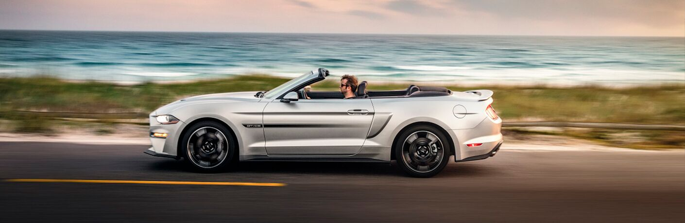 2019 Ford Mustang convertible driving by water