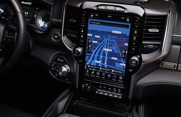 2019 Ram 1500 interior shot closeup of dashboard infotainment display screen in use