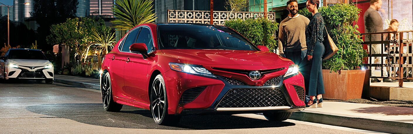 red 2019 Toyota Camry on street side