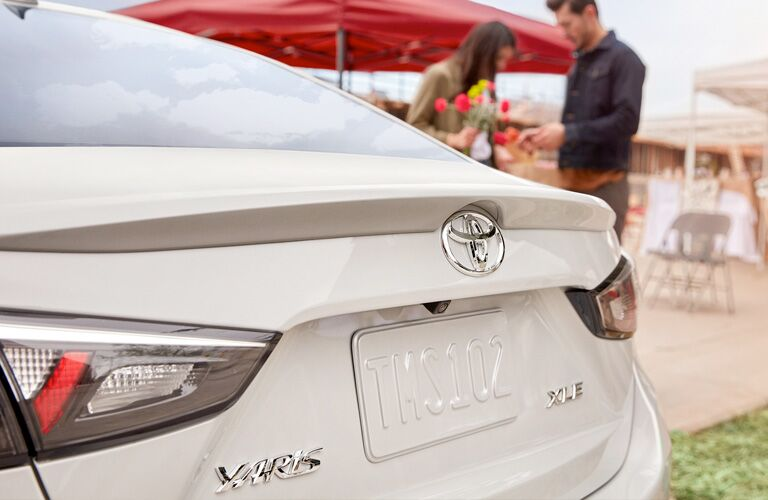 Rear view of white 2019 Toyota Yaris
