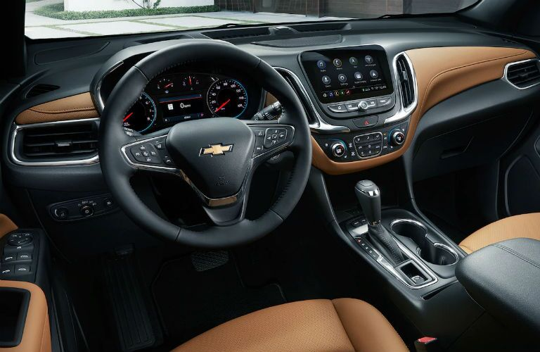 2019 Chevy Equinox interior driver's view shot of steering wheel, seating material, transmission knob, and dashboard layout