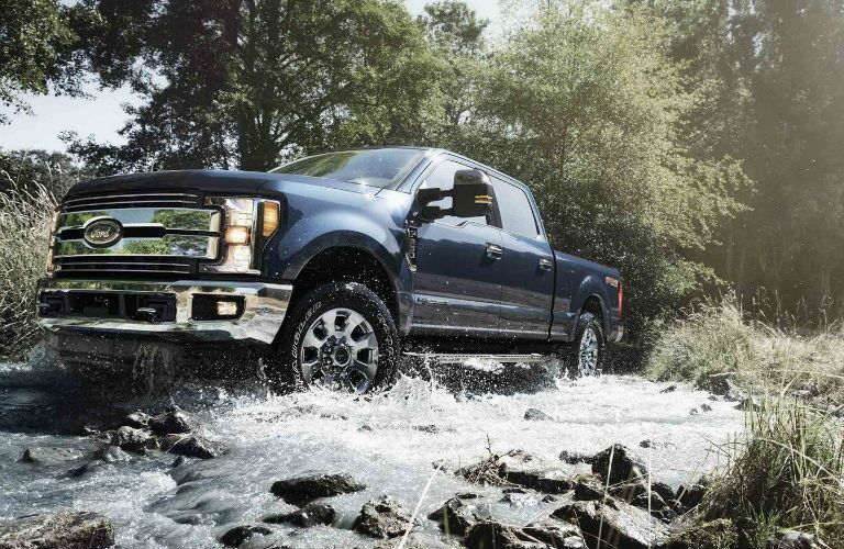 2019 Ford Super Duty LARIAT Crew Cab driving through water