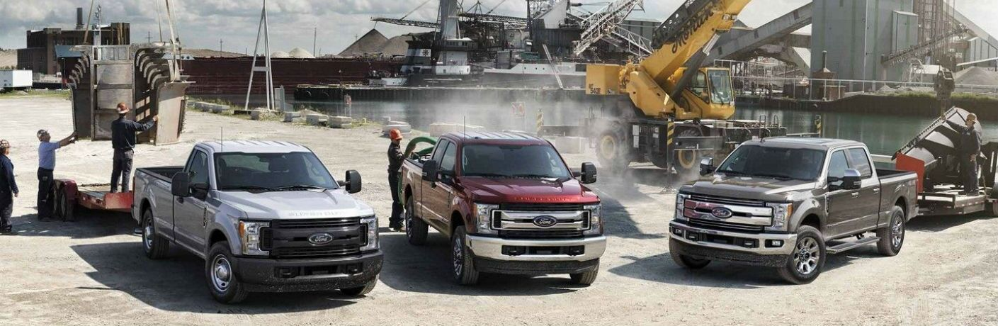 2019 Ford F-250, 2019 Ford F-350 and 2019 Ford F-450 lined up at a busy work site