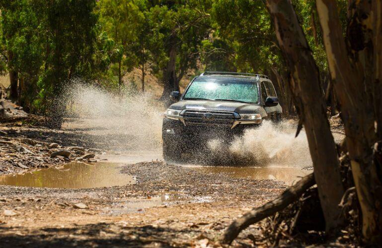 2019 Toyota Land Cruiser driving through muddy waters