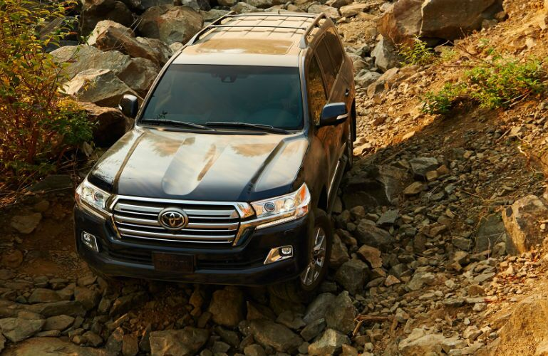 2019 Toyota Land Cruiser in a rocky ditch