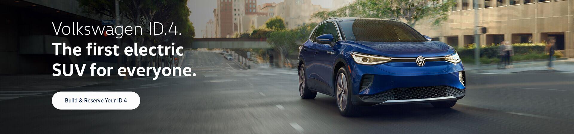 An ID.4 in Dusk Blue Metallic drives on an urban road.