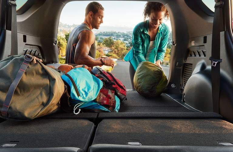 Cargo area of 2017 Toyota RAV4 with collapsed seats