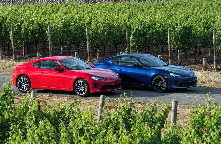Two Toyota 86 models in a vineyard
