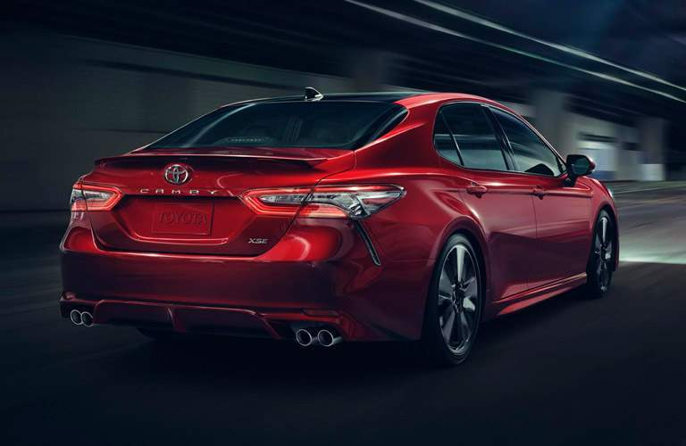 Rear/side profile of red 2018 Toyota Camry