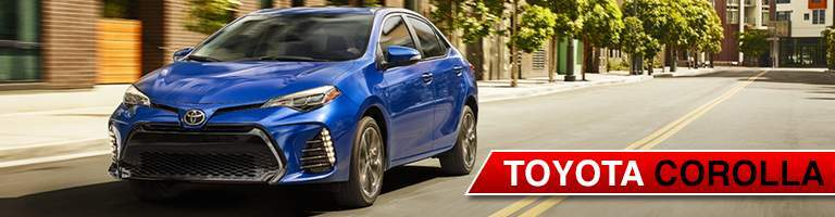 Blue 2018 Toyota Corolla set in a town