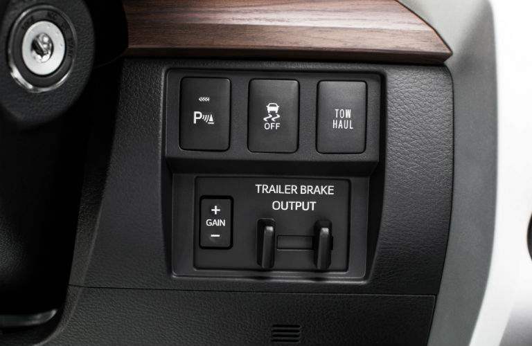 A close up photo of the trailer control system buttons for the 2018 Toyota Tundra