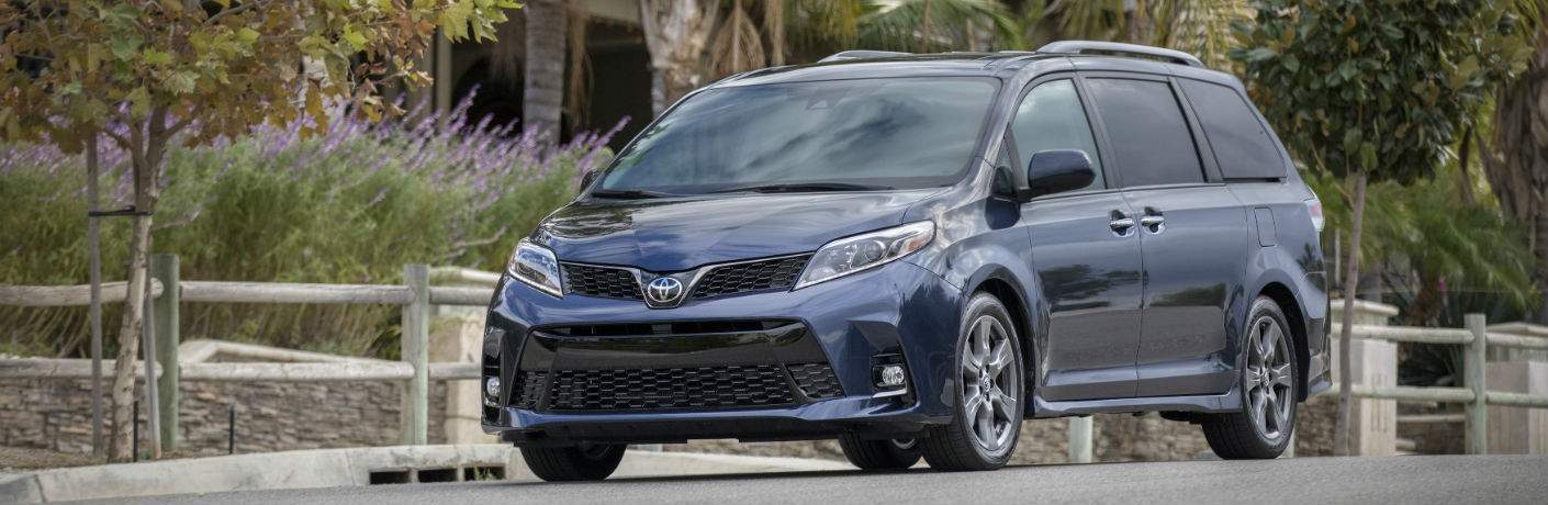 A front left quarter view of a blue 2018 Toyota Sienna