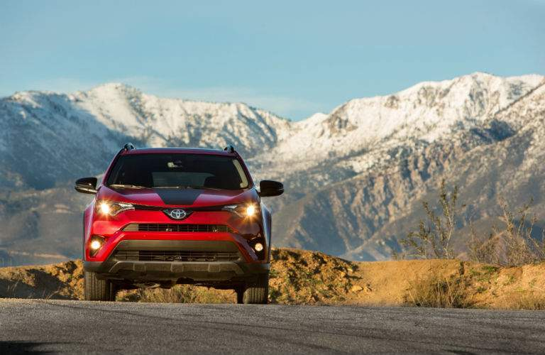 2018 RAV4 Adventure come straight at the camera with mountains in the background