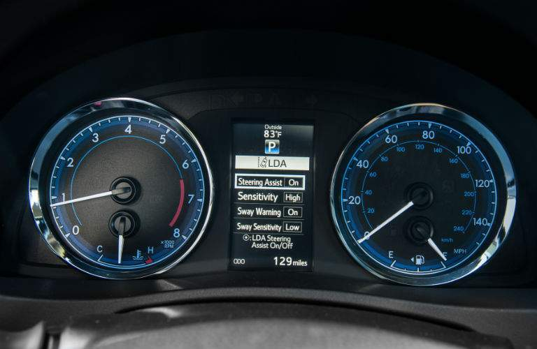 Center gauge cluster showing active safety systems activated