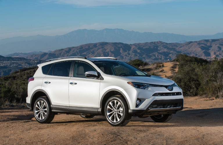 White 2018 RAV4 with desert mountains in the background