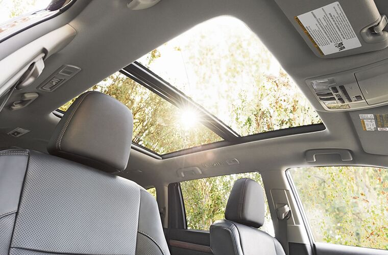 An interior photo showing the available sunroof in the 2018 Toyota Highlander.