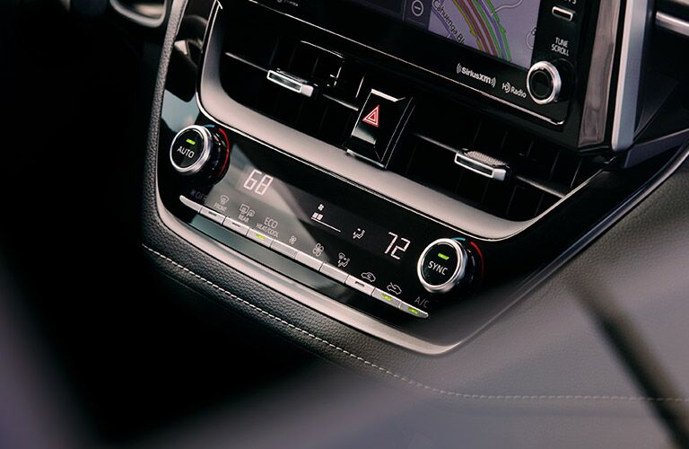 A photo of the climate control system in the 2019 Corolla Hatchback.
