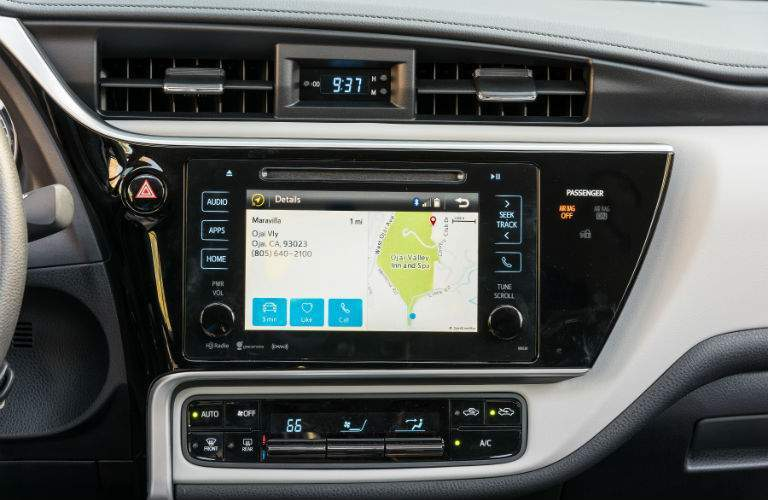 Available GPS navigation system on the touchscreen being shown in the 2018 Toyota Corolla