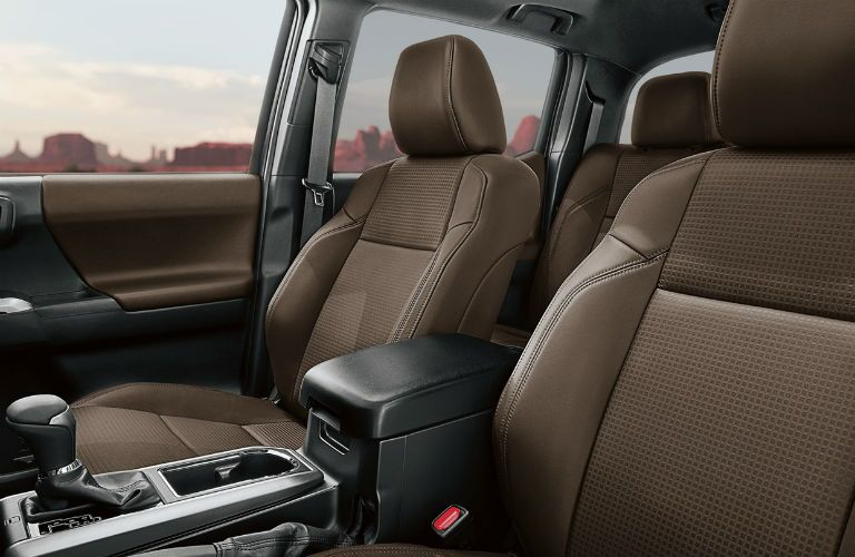 An interior photo of the 2018 Toyota Tacoma showing the truck's comfortable front seats.