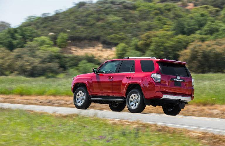 A photo of a red 2018 Toyota 4Runner showing the integrated trailer hitch that is standard equipment